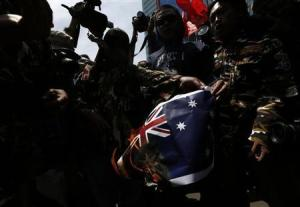 Protesters burn an Australian flag during a protest in front of the Australia embassy in Jakarta, November 21, 2013. (Beawiharta/Reuters)