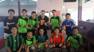 """Mr. Christopher and his students building frienships through a game of Futsal."""""""
