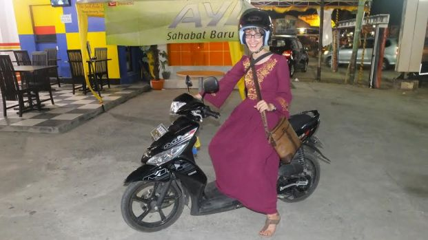 Rebecca Kulik, placed in Gorontalo, wearing a Krawong, traditonal Gorontalo fabric after a wedding.