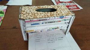 A tissue box from recycled newspaper.