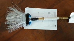 A broom made of bamboo and stripped plastic from water bottles.