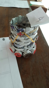 A pencil holder woven from newspaper.