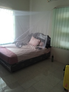 Caitlin's bedroom with A/C and mosquito net.