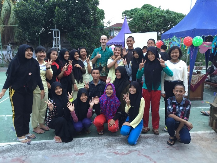 Izaak Earnhardt with students celebrating Dayak culture at SMKN Binaan.