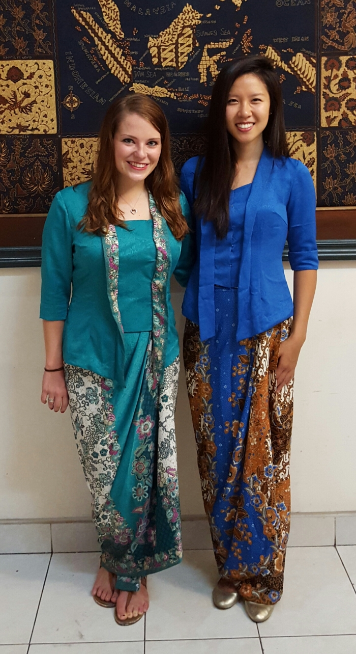Julia Xia and Kendra Reiser, ETA's placed in Yogyakarta, wear traditional javanese kebayas made by a local tailor with fabric bought from Malioboro.