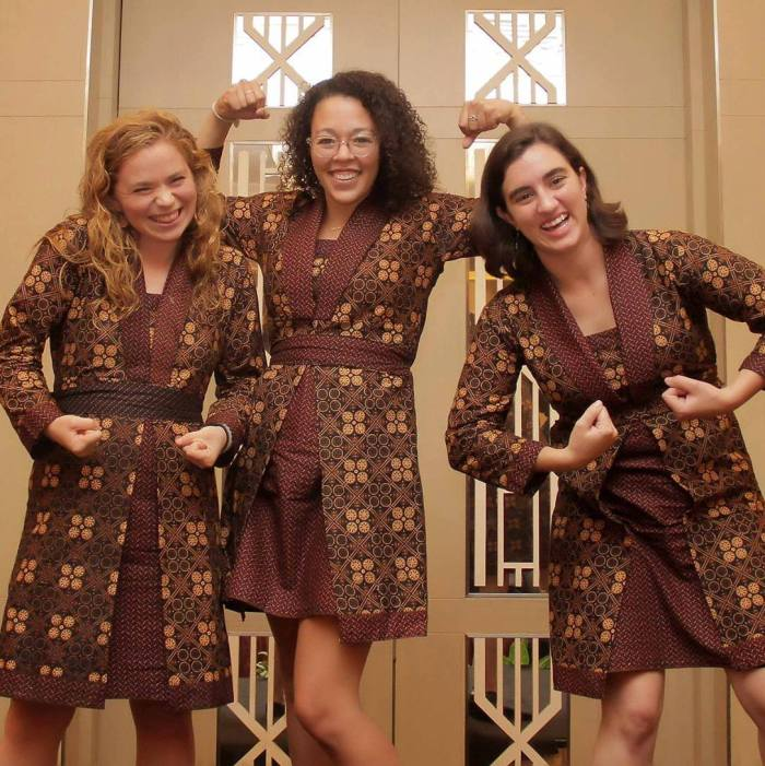 "Clare McLaughlin, Kelsey Roggensack, and Grace Wivell, the ""Gorontalo Gals,""regularly wear matching batik dresses they bought during orientation in Bandung."