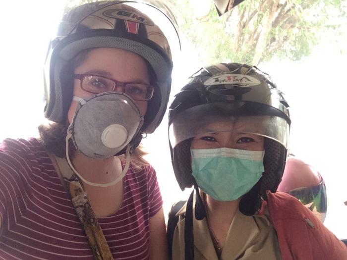 Mackenzie and a fellow teacher at SMA5 Palangkaraya don masks and helmets in preparation for the daily commute to school.