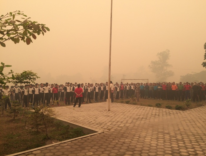 The smog must be seen to be believed at the weekly flag-raising ceremony at SMA5 Palangkaraya.