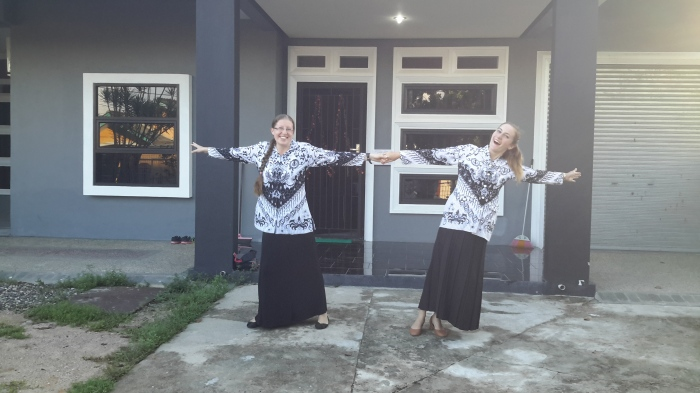Sitemates Caitlin Jordan (left) and Kelly Fitzgerald (right) pose in front of their shared home the morning of Hari Guru [Teacher's Day]. They are wearing the black-and-white batik uniform of Persatuan Guru Republik Indonesia (PGRI), the Indonesian National Teacher's Association.