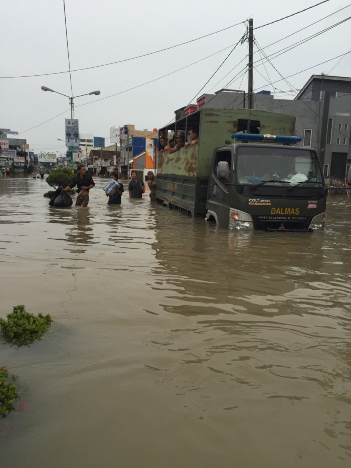 Members of the Indonesian police, coast guard, and military were on hand to help civilians trapped in their homes. I was impressed that the trucks still worked in water that was waist-deep in parts.