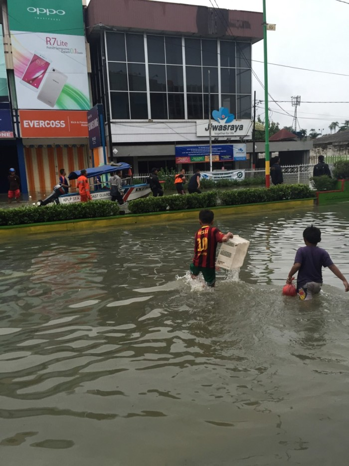 While children had a great time playing in the flooded streets, adults were more concerned with rescue efforts.