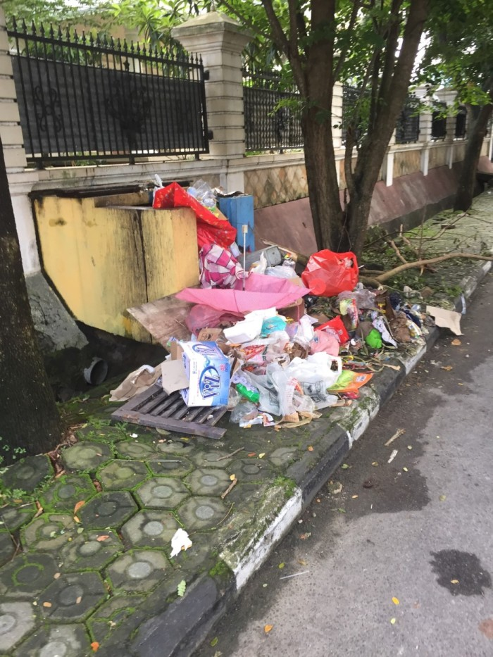 Trash piles remain an issue in the city long after the flood waters have receded.