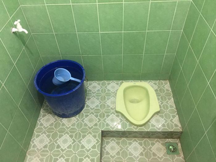 A typical squat toilet. Photo credit: Vinny Owen.