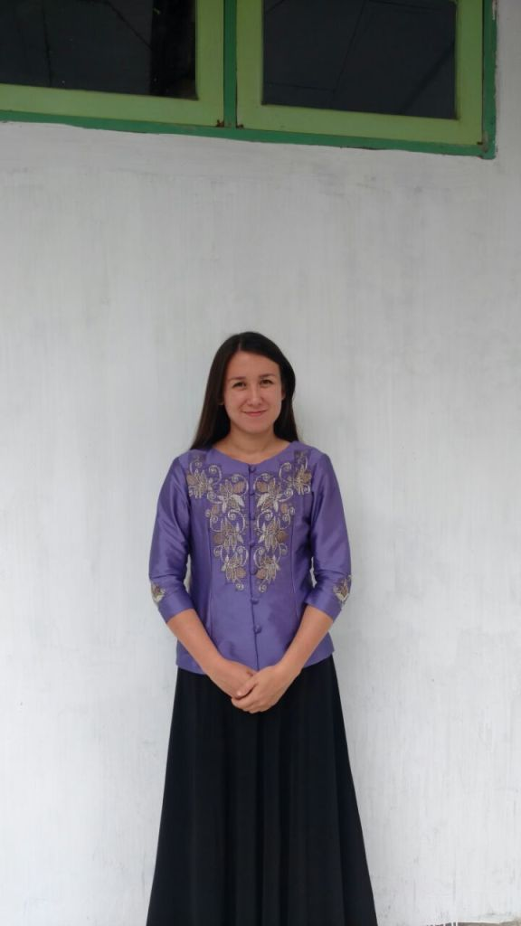 Karawang (sometimes spelled kerawang) is a type of hand-made fabric that is unique to Gorontalo in northern Sulawesi. JoAnn Doll, currently living in Gorontalo, is wearing an example of this fabric. Karawang refers to the hand-stitched embroidery that is typically a floral motif but designs vary by village. Fabric is usually a solid color, although combinations of batik and karawang are increasingly popular. Karawang is typically worn as formal wear and can also be part of a uniform such as those worn by teachers at schools across the province. Clothes completely embroidered with karawang are very expensive because they are hand-made. Small items with accents of karawang such as scarves and fans are common souvenirs from Gorontalo.