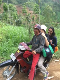An ojek is a motorcycle taxi. Anyone can become an ojek driver, such as this farmer in East Java who kindly offered his services to tourists who wanted to see a waterfall that was off the beated path.