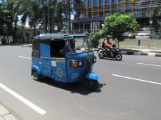 A bajai is a three-wheeled, self-enclosed vehicle similar to tuk-tuks in Thailand. Bajais are most commonly found in Jakarta.