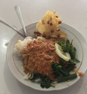 Nasi pecel is a delicious mix of rice, vegetables, and peanut sauce.